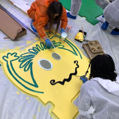 Team decorating a headboard at a live event